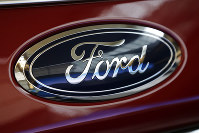 This Feb. 15, 2018, file photo shows a Ford logo on a vehicle at the Pittsburgh Auto Show in Pittsburgh. Ford is recalling about 550,000 cars and SUVs in North America to fix a gearshift problem that could cause the vehicles to roll away unexpectedly. (AP Photo/Gene J. Puskar)