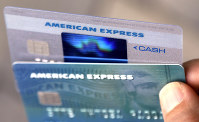 In this July 18, 2016, file photo, American Express credit cards are seen, in North Andover, Mass. (AP Photo/Elise Amendola)