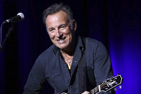 In this Nov. 10, 2015 file photo, Bruce Springsteen performs at the 9th Annual Stand Up For Heroes event in New York. (Photo by Greg Allen/Invision/AP)