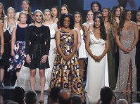 Former gymnast Sarah Klein, former Michigan State softball player Tiffany Thomas Lopez and gymnast Aly Raisman, from left in front, and others who suffered sexual abuse accept the Arthur Ashe Award for Courage at the ESPY Awards at the Microsoft Theater on July 18, 2018, in Los Angeles. (Photo by Phil McCarten/Invision/AP)
