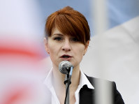 In this photo taken on April 21, 2013, Maria Butina, leader of a pro-gun organization in Russia, speaks to a crowd during a rally in support of legalizing the possession of handguns in Moscow, Russia. (AP Photo)