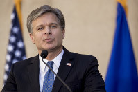 In this Sept. 28, 2017, file photo, FBI Director Chris Wray speaks at his installation ceremony at the FBI Building in Washington. (AP Photo/Andrew Harnik)