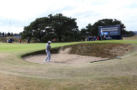 Tiger Woods of the U.S. plays out of a bunker on the 13th hole during a practice round ahead of the British Open Golf Championship in Carnoustie, Scotland, on July 18, 2018. (AP Photo/Jon Super)