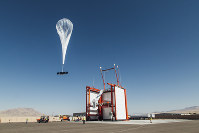 In this photo provided by Loon LLC, a balloon launches from Loon's launch site Winnemucca, Nev. (Loon LLC via AP)