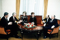 In this November 1985 file photo, U.S. President Ronald Reagan, his wife Nancy Reagan and an aide, left, meet with Soviet President Mikhail Gorbachev, his wife Raisa Gorbachev and an aide, in Geneva, Switzerland. (AP Photo)
