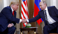 In this July 16, 2018, file photo, U.S. President Donald Trump, left, and Russian President Vladimir Putin shake hands at the beginning of a meeting at the Presidential Palace in Helsinki, Finland. (AP Photo/Pablo Martinez Monsivais, File)