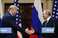 U.S. President Donald Trump shakes hand with Russian President Vladimir Putin at the end of the press conference after their meeting at the Presidential Palace in Helsinki, Finland, on July 16, 2018. (AP Photo/Alexander Zemlianichenko)