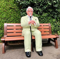 A sitting figure of Colonel Sanders, the founder of Kentucky Fried Chicken. (Photo courtesy of KFC Holdings Japan Ltd.)