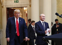 In this July 16, 20198, photo, U.S. President Donald Trump, left, and Russian President Vladimir Putin arrive for a news conference at the Presidential Palace in Helsinki, Finland. (AP Photo/Pablo Martinez Monsivais)