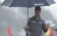 Zach Johnson of the U.S. walks along the 12th fairway during the second round of the British Open Golf Championship in Carnoustie, Scotland, on July 20, 2018. (AP Photo/Alastair Grant)