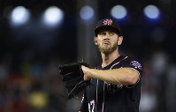 Washington Nationals starting pitcher Stephen Strasburg pauses between throws during the fifth inning of a baseball game against the Atlanta Braves at Nationals Park in Washington, on July 20, 2018. (AP Photo/Susan Walsh)