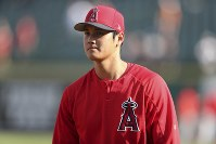 Los Angeles Angels' starting pitcher Shohei Ohtani walks to the dugout during warm-ups for a baseball game against the Detroit Tigers, on May 29, 2018, in Detroit. (AP Photo/Carlos Osorio)