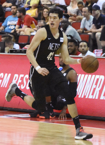 Yuta Watanabe of the Brooklyn Nets dribbles the ball during a match against the Houston Rockets in Las Vegas on July 11, 2018. (Kyodo)
