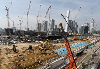 In this July 17, 2018 file photo, the Olympic village is seen under construction in Tokyo's Chuo Ward, roughly two years ahead of the opening of the games. (Mainichi)
