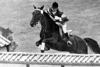 Hiroshi Hoketsu competes in the equestrian show jumping event at the 1964 Tokyo Olympic Games on Oct. 24 that year. (Mainichi)
