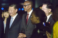 President Paul Kagame of Rwanda, center, greets President Xi Jinping of China, center left, after his arrival or a two day state visit in Kigali, Rwanda, on July 22, 2018. (AP Photo)