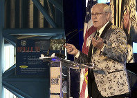 In this July 15, 2017, file photo, Andrew Aldrin, Apollo 11 astronaut Buzz Aldrin's son, speaks at the commemoration for the upcoming anniversary of the 1969 mission to the moon and a gala for the non-profit space education foundation, ShareSpace Foundation, at the Kennedy Space Center in Cape Canaveral, Fla. (AP Photo/Alex Sanz)