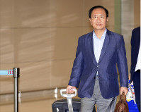 In this July 22, 2018, photo, South Korean lawmaker Roh Hoe-chan arrives after visiting the U.S. at Incheon International Airport in Incheon, South Korea. (Han Jong-chan/Yonhap via AP)