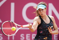 Alize Cornet of France, returns a ball to Mandy Minella of Luxembourg, during the final game at the WTA Ladies Championship tennis tournament in Gstaad, Switzerland, on July 22, 2018. (Anthony Anex/Keystone via AP)