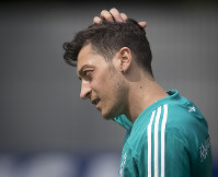 In this June 14, 2018 file photo Mesut Ozil scratches his head during a training session of the German team at the 2018 soccer World Cup in Vatutinki near Moscow, Russia. (AP Photo/Michael Probst)