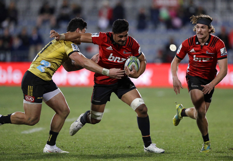 88150954862 Crusaders Pete Samu runs at Hurricanes Ben Lam, left, as teammate George  Bridge, right, watches during their Super Rugby semifinal in Christchurch,  ...
