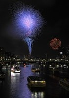 Fireworks are seen in the night sky during the Sumida River Fireworks Festival from Kuramae Bridge on the border between Tokyo's Taito and Sumida wards on July 29, 2018, after the event was postponed a day due to Typhoon Jongdari. (Mainichi)