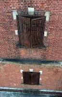 爆風でゆがんだ鉄扉が残る旧陸軍広島被服支廠=広島市南区で2018年8月1日、小型無人機で山田尚弘撮影
