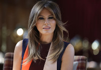 In this July 13, 2018 file photo, first lady Melania Trump takes a seat during a visit to The Royal Hospital Chelsea in central London. (AP Photo/Luca Bruno, Pool)