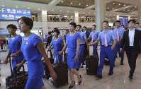 In this July 29, 2018 photo, a North Korean delegation arrives for joint Asian Games training with South Koreans at Incheon International Airport in Incheon, South Korea. (AP Photo/Ahn Young-joon)