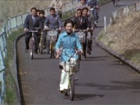 Empress Michiko (then the Crown Princess) rides a bicycle at Kodomonokuni (Children's Land) in Yokohama in March 1976. (Image courtesy of MBS)