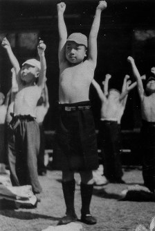 Emperor Akihito, age 10, conducts physical training with his classmates at a facility attached to the Tamozawa Imperial Villa where he was evacuated to in the city of Nikko in Tochigi Prefecture north of Tokyo. (Mainichi)