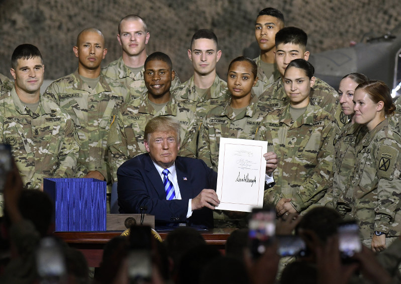 Trump signs $716 bil. defense policy bill