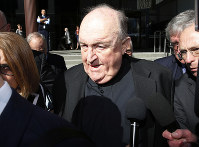 Former Adelaide Archbishop Philip Wilson leaves Newcastle Local Court, in Newcastle, Australia, after a post-sentence decision, on Aug. 14, 2018. (Darren Pateman/AAP Image via AP)