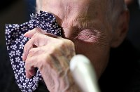 The oldest attendee Harumi Serigano, 102, wipes her eyes with a handkerchief as she is interviewed ahead of an annual ceremony to mourn the war dead at the Nippon Budokan arena in Tokyo's Chiyoda Ward on Aug. 15, 2018. (Mainichi)