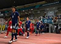 【日本―ネパール】 アジア大会初戦に臨む日本代表の選手たち=インドネシア西ジャワ州チカランのウィバワ・ムクティ競技場で2018年8月14日、宮間俊樹撮影