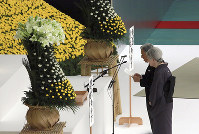 Japan's Emperor Akihito delivers his remarks with Empress Michiko during a memorial service at Nippon Budokan martial arts hall on Aug. 15, 2018, in Tokyo's Chiyoda Ward. (AP Photo/Eugene Hoshiko)