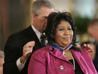 In this Nov. 9, 2005 photo, U.S. President George W. Bush awards singer Aretha Franklin the Presidential Medal of Freedom Award, the highest civilian award, in the East Room of the White House in Washington. (AP Photo/Lawrence Jackson)