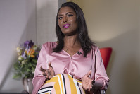 Former White House staffer Omarosa Manigault Newman speaks during an interview with The Associated Press, in New York, on Aug. 14, 2018. (AP Photo/Mary Altaffer)
