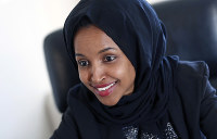 In this Jan. 5, 2017 photo, state Rep. Ilhan Omar is interviewed in her office two days after the 2017 Legislature convened in St. Paul, Minnesota. (AP Photo/Jim Monem)