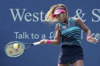 Naomi Osaka, of Japan, returns to Maria Sakkari, of Greece, at the Western & Southern Open, on Aug. 14, 2018, in Mason, Ohio. (AP Photo/John Minchillo)