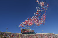 In this Oct. 14, 2017 photo, balloons are released in Memorial Stadium before an NCAA college football game between Indiana and Michigan in Bloomington, Indiana. (AP Photo/AJ Mast)