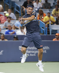 Kei Nishikori, of Japan, returns to Stan Wawrinka, of Switzerland, during the Western & Southern Open tennis tournament on Aug. 15, 2018, in Mason, Ohio. (AP Photo/John Minchillo)