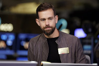 In this Nov. 19, 2015 file photo, Square CEO Jack Dorsey is interviewed on the floor of the New York Stock Exchange. (AP Photo/Richard Drew)
