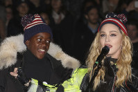 In this Nov 7, 2016 file photo, U.S. Singer Madonna, right, and her son David Banda perform in support of Democratic presidential candidate Hillary Clinton at Washington Square Park. (Photo by Greg Allen/Invision/AP)