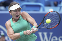 Simona Halep, of Romania, returns to Ajla Tomljanovic, of Australia, at the Western & Southern Open tennis tournament, on Aug. 16, 2018, in Mason, Ohio. (AP Photo/John Minchillo)