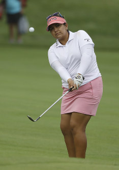 Lizette Salas chips to the 13th green during the first round of the Indy Women in Tech Championship golf tournament, on Aug. 16, 2018, Indianapolis. (AP Photo/Darron Cummings)