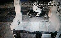 A security camera image shows a man riding a black motorcycle near where a bag-snatching incident occurred on Aug. 13, 2018, the day after Junya Hida escaped from Tondabayashi Police Station. (Photo courtesy of a local resident)