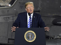 In this Aug. 13, 2018 file photo, President Donald Trump speaks before signing a $716 billion defense policy bill named for Sen. John McCain in Fort Drum, N.Y. (AP Photo/Hans Pennink)