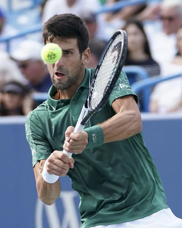 Federer sets up finals clash with Djokovic