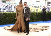In this May 1, 2017 file photo, Priyanka Chopra, left, and Nick Jonas attend The Metropolitan Museum of Art's Costume Institute benefit gala celebrating the opening of the Rei Kawakubo/Comme des Garçons: Art of the In-Between exhibition in New York. (Photo by Charles Sykes/Invision/AP, File)